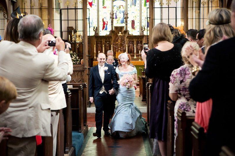 Bride & groom exiting church copy