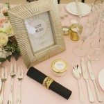 Black napkins and gold napkin rings