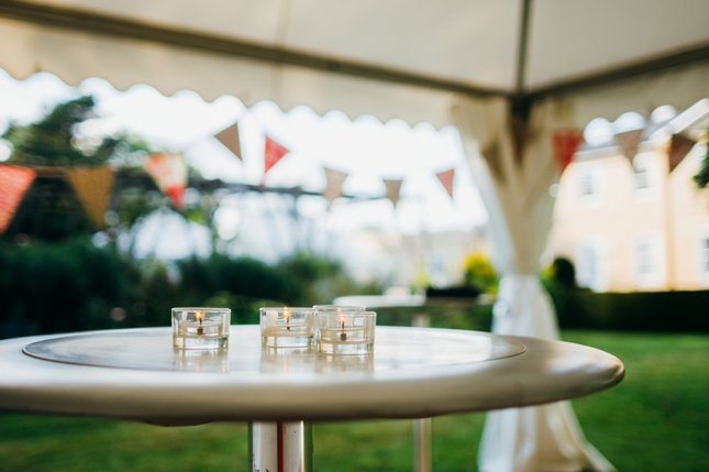 Poseur tables in garden