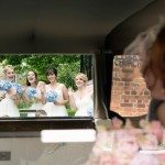 claire-richard-2-Bridesmaids waving to bride in the wedding car